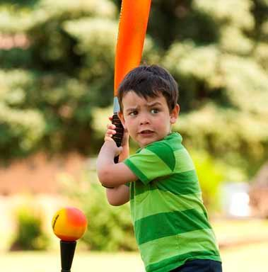 Boy playing tee ball