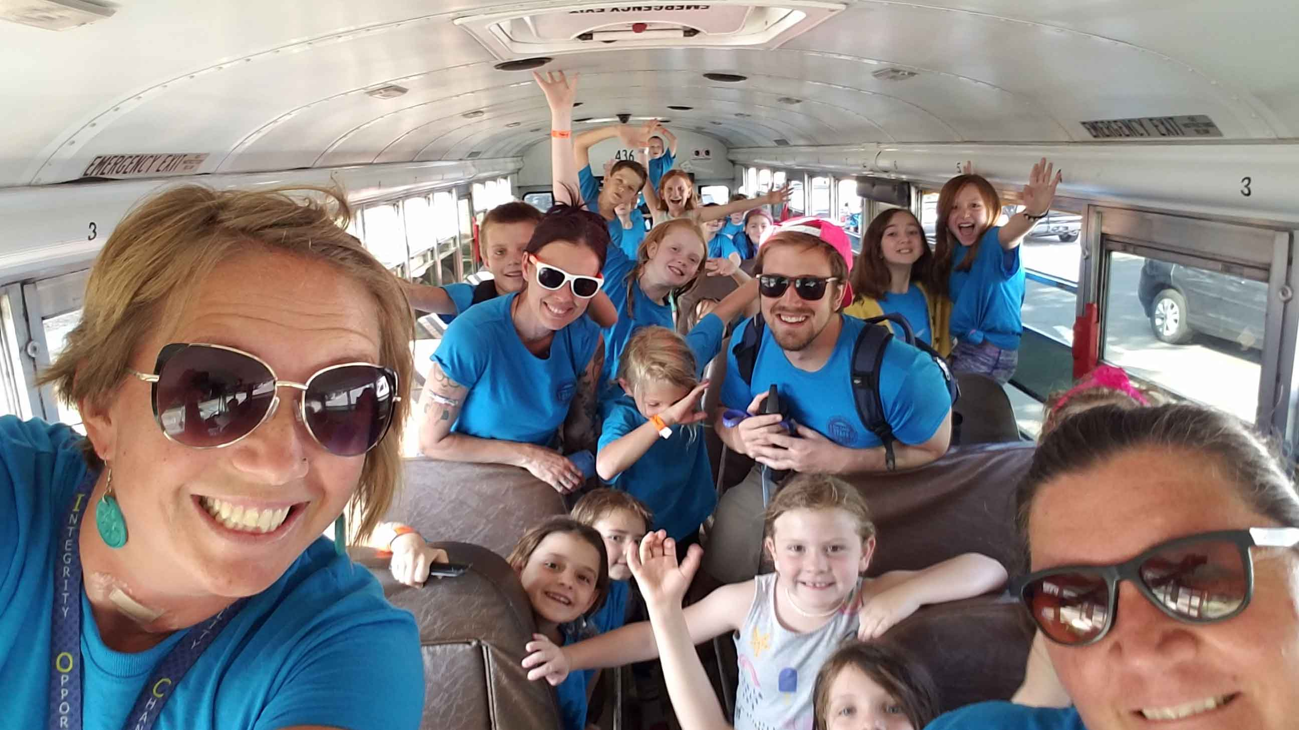 Group selfie on the field trip bus