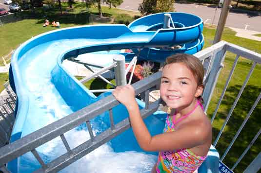 girl at the top of water slide